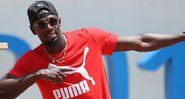 Usain Bolt visita comunidade carente na Jamaica - Getty Images