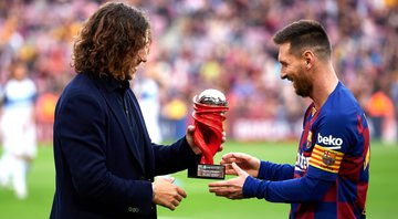 Carles Puyol e Lionel Messi - GettyImages